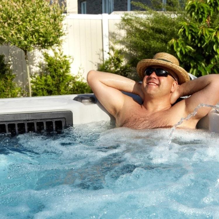 a man in a hot tub